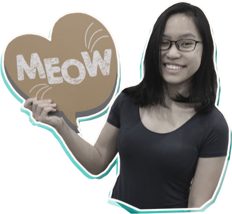 Profile photo of Olivia holding a sign that says 'Meow'